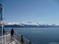 Alaskan moutains and cruise ship in the distance as viewed from NCL Pearl.jpg